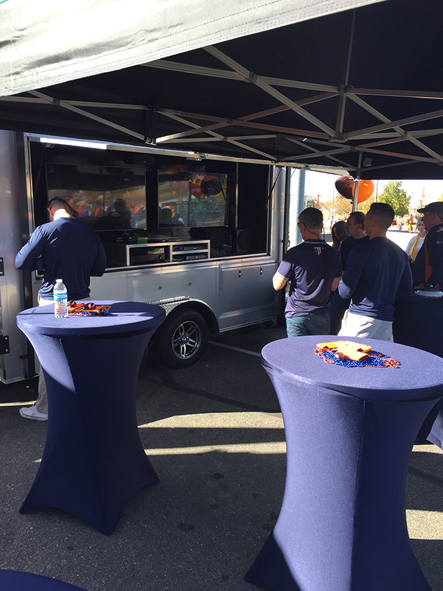 denver-tailgating-trailer-watching-tv